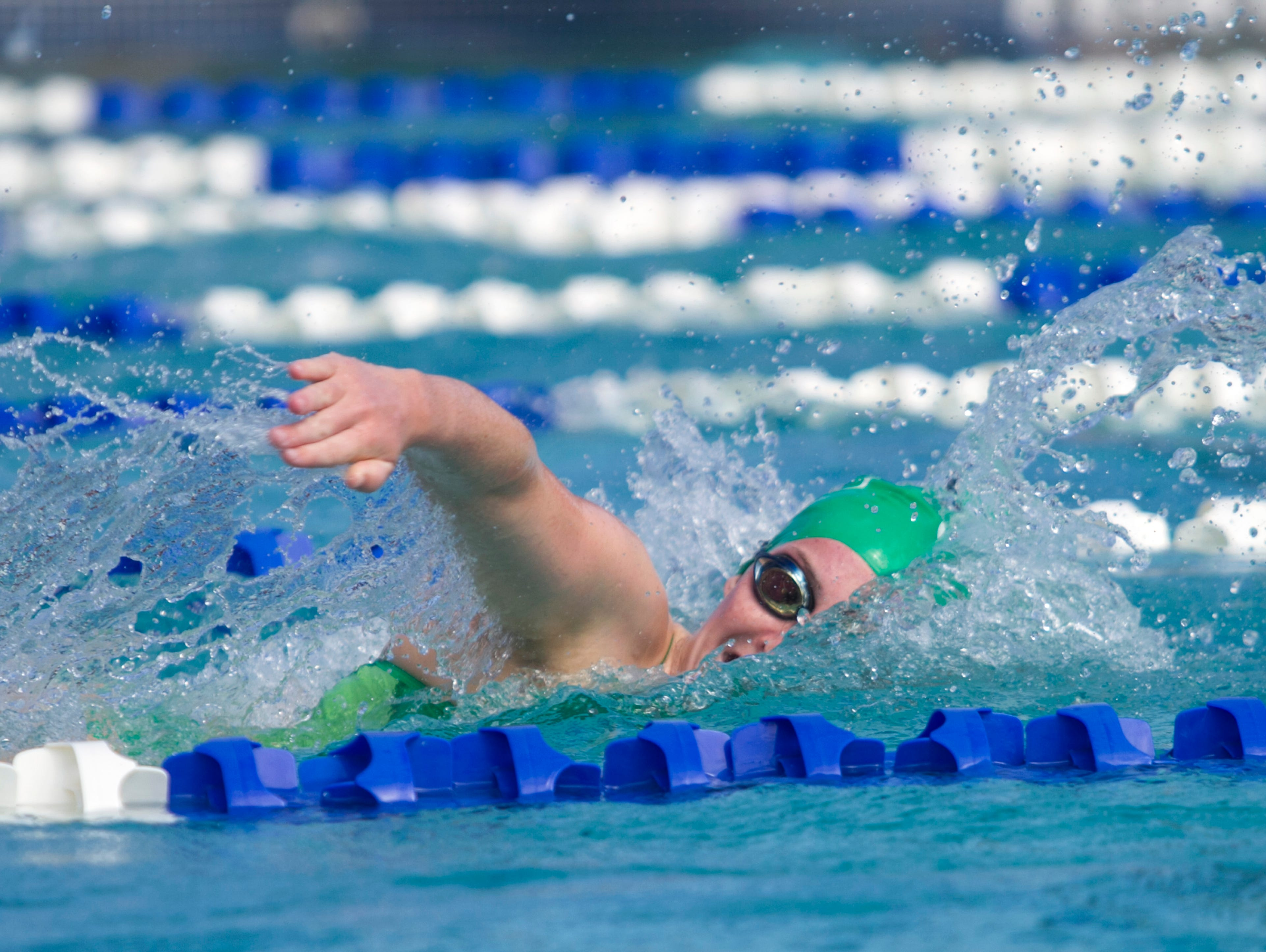 Kendall Brent of Fort Myers High School swims in the Girls 200 Yard Freestyle at the LCAC Championships on Thursday.