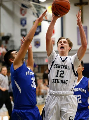 Central Catholic's Avery Denhart gets past Frankfort's Steven Ceballos for a score Friday, January 22, 2016, in Lafayette. CC beat the visiting Hot Dogs 88-75.