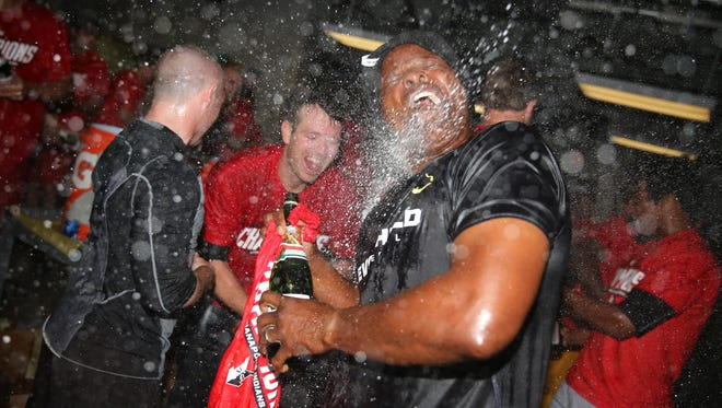 The Indians celebrate after clinching the IL West Title. With lots and lots of champagne.