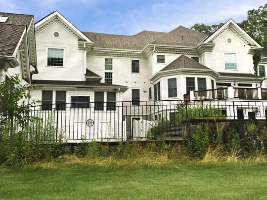 The back of the 3.2-acre property includes an indoor