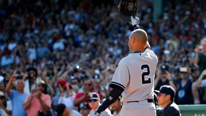 The Yankees' Derek Jeter tips his cap to the crowd at Fenway Park after coming out of the game for a pinch runner in the third inning of Sunday's game against the Boston Red Sox. Jeter had a hit and an RBI in the final at-bat of his career. The Yankees won the game 9-5.