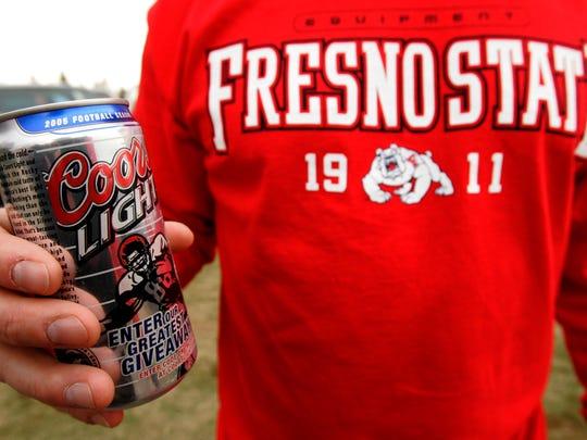 Bulldog football fan Jay Jones, of Fresno, holds a
