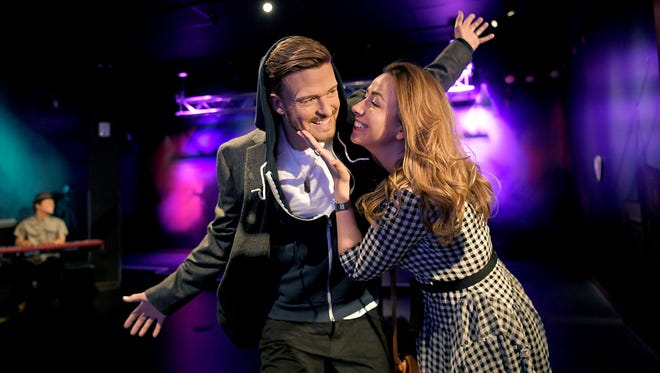 Olga Puzanova gets close to a wax figure of Justin Timberlake as family members take photographs at the new Madame Tussauds Nashville attraction during a preview tour on Thursday, April 13, 2017. This is the company's first U.S. attraction that focuses solely on music.