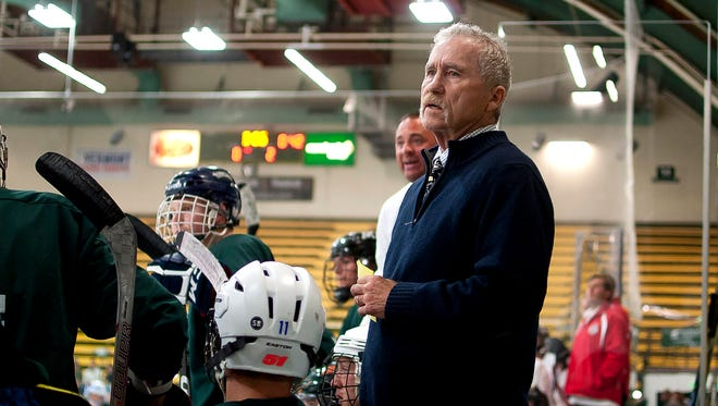 Bill O'Neil watches the action from the Vermont bench during the 25th annual Make-A-Wish Hockey Classic on Saturday at Gutterson Fieldhouse.