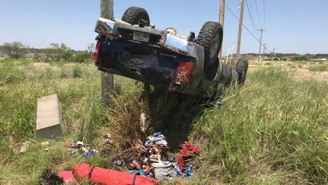 A vehicle overturned near Family Power Sports and Jim Bass Nissan dealership off Loop 306 in San Angelo early Monday afternoon, June 11, 2018.