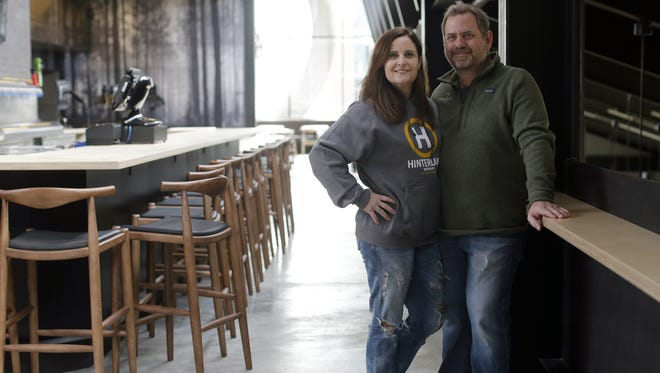 Bill and Michelle Tressler, owners of Hinterland Brewery, stand in the second-floor dining area of their new facility located in the Green Bay Packers' Titletown District on March 31. The restaurant and brewery is tentatively scheduled to open April 11, 2017.