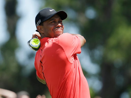 Tiger Woods hits from the 16 tee during the final round of The Players Championship golf tournament Sunday, May 10, 2015, in Ponte Vedra Beach, Fla. (AP Photo/Lynne Sladky)
