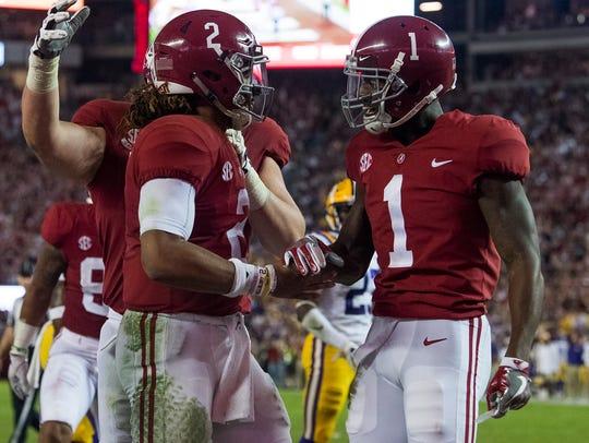 Alabama quarterback Jalen Hurts (2) and Alabama wide