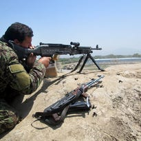 Afghan National Army soldiers fire artillery during a battle with Taliban insurgents in the Chahardara district of Kunduz province north of Kabul on May 3.