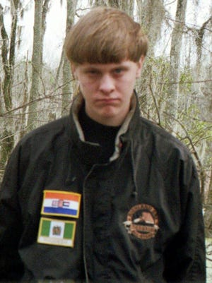 Dylann Roof is pictured in a self-portrait wearing the flag patches of now-defunct  Rhodesia and apartheid South Africa, states that were linked to white supremacy.