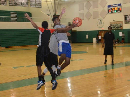 ANI Markel Brown Brooklyn Nets player and former Peabody basketball player Markel Brown held a basketball camp for kids at his high school alma mater Friday, June 5, 2015. The kids played three-on-three.-Melinda Martinez/The Town Talk