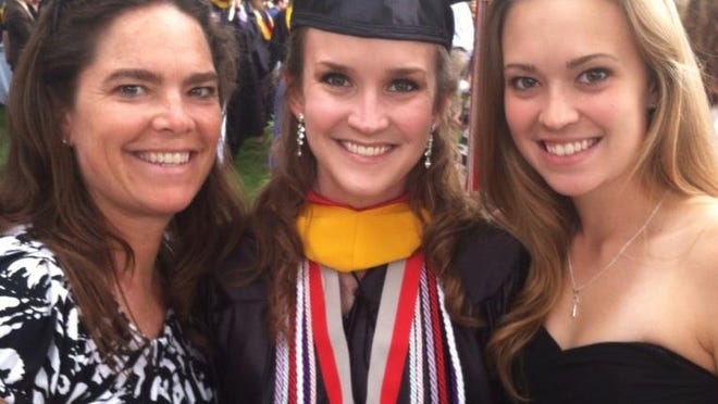 Karlee Henderson (right) stands with her sister Kelsea and mother Pam two years ago at Kelsea's graduation from St. Joseph's University. Karlee is following her sister's path, set to study pediatric medicine at Cooper Medical School of Rowan University following Tuesday's graduation from Rowan University. The women became fascinated with medicine as children when Kelsea faced a poor cancer prognosis.