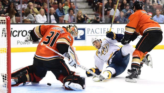 Predators defenseman Seth Jones is knocked to the ice as Frederik Andersen makes a save during the second period.