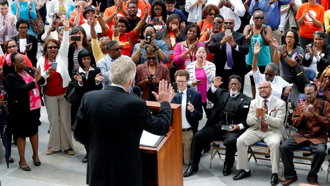 Virginia Gov. Terry McAuliffe announces the restoration of rights to felons on April 22, 2016.