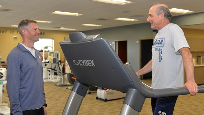 Nate Vandervest, left, is the running specialist at Bellin Health's Sports Medicine Movement Performance Lab. By identifying runners' weaknesses and prescribing exercises to activate and strengthen specific muscles, Vandervest can help runners avoid injuries and improve performance.