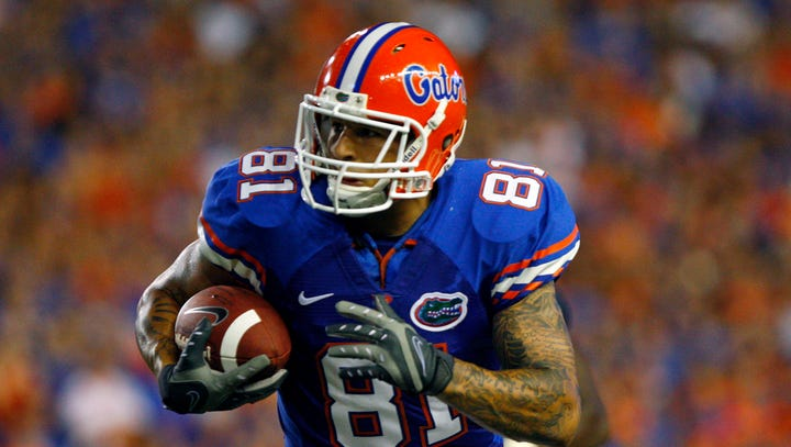 USA TODAY Archives: Aaron Hernandez honors father's memory with tattoos