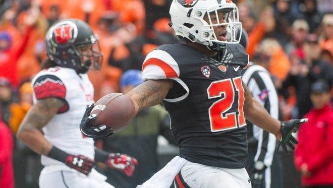Oct 15, 2016; Corvallis, OR, USA; Oregon State running back Artavis Pierce (21) scores on an 18-yard touchdown run in the third quarter of Saturday's 19-14 loss to No. 21 Utah at Reser Stadium.