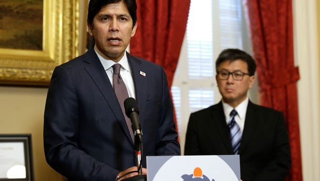 Senate President Pro tem Kevin de Leon, D-Los Angeles, accompanied by state Treasurer John Chiang, right, says he will move forward with his plan to automatically enroll private-sector workers in state run retirement plans, during a news conference, Thursday in Sacramento.
