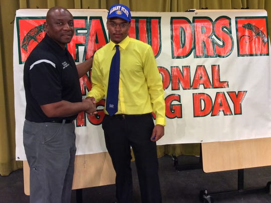 Alongside FAMU DRS athletic director Terrence Milton, Rattlers senior DeTron Hall signed with Albany State.