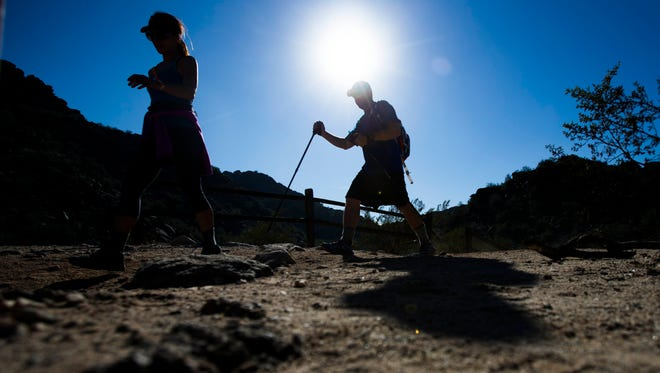 Hikers make their way up Holbert trail during the Seven Summits hike at the South Mountain Holbert trail in Phoenix, Ariz., on Nov. 14, 2015.