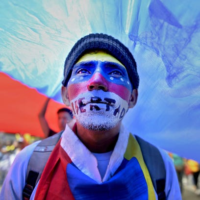 People march during a protest in Caracas against the government of Venezuelan President Nicolas Maduro.