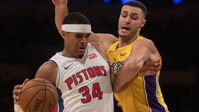 Pistons forward Tobias Harris, left, drives past Lakers forward Larry Nance Jr. during the first half on Tuesday, Oct. 31, 2017, in Los Angeles.