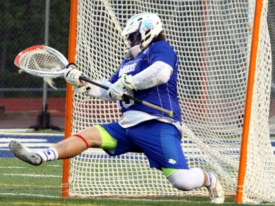 Catholic Central goalie Hunter Braun stretches out for the save in Saturday's Catholic League final.