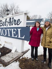Sisters Brenda and Becky Bouchard stand outside the former Bel-Aire Motel on Shelburne Street in Burlington on Tuesday, March 21, 2017.