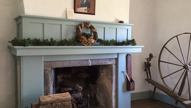 President James Monroe looks down from the parlor fireplace mantel, ready for the Holiday Open House at the Wolcott Keeper's House on Dec. 9.