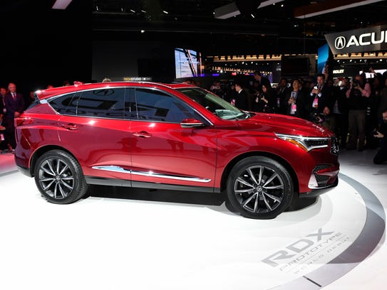 Members of the media photograph the Acura RDX at the