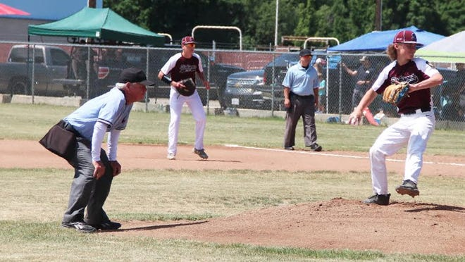 Siskiyous U17 pitcher Shawn Graves throws as the umpire watches from behind the mound, instead of behind the plate, like normal, during game one of a doubleheader versus Tehama at Hibbard Field on Saturday.
