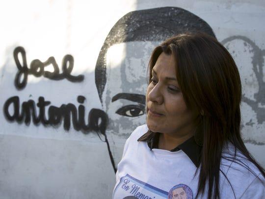 Araceli Rodriguez stands before a Nogales, Sonora,