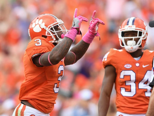 Clemson receiver Artavis Scott (3) reacts after catching a TD in overtime against North Carolina State at Memorial Stadium in Clemson.