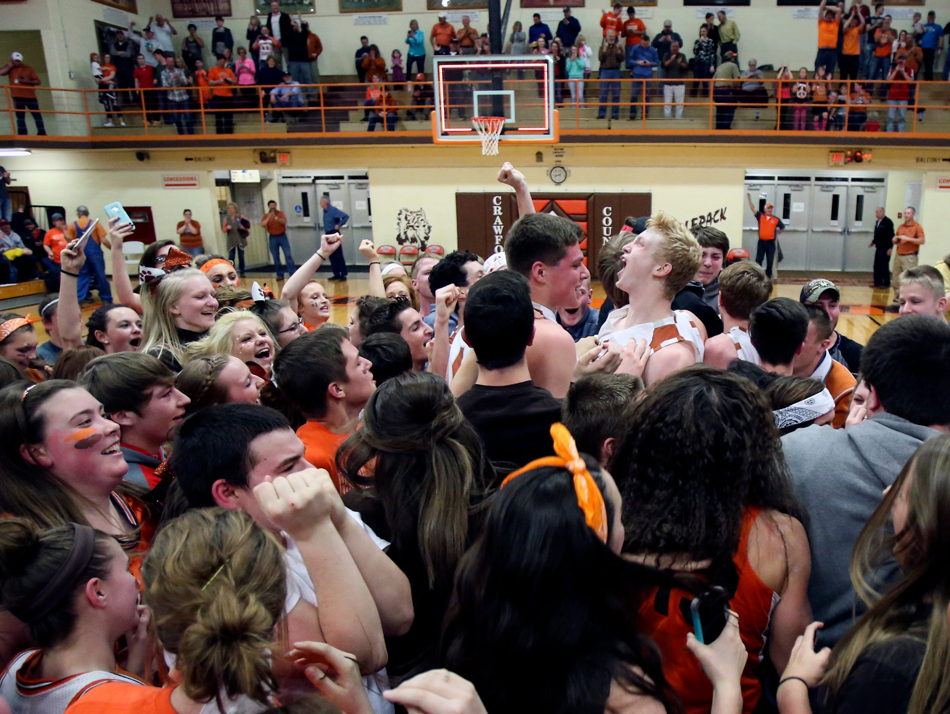 Crawford County celebrates after defeating top-ranked Providence in the Class 2A Sectional 46 championship game. Mar. 4, 2017