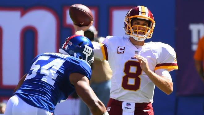 Giants defensive end Olivier Vernon goes after Washington quarterback Kirk Cousins. Vernon and the rest of his unit will have to challenge the Minnesota Vikings in Monday night's game.