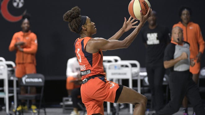 Connecticut Sun guard Jasmine Thomas (5) goes up for a breakaway basket during the second half of Game 1 of a WNBA basketball semifinal round playoff game against the Las Vegas Aces, Sunday in Bradenton, Fla.