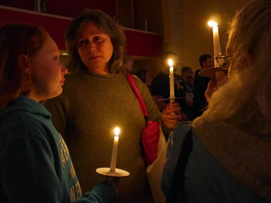 Nivra Martin comforts her grand-daughter Julie during a candlelight vigil for Meredith Furr, a fourth-grader at Guy K. Stump Elementary School at the Destiny Family Center, Stuarts Draft Sunday March, 13, 2016. Furr died after a difficult fight with cancer. Julie Martian was one of Meredith Furr's closest friends, they even shared the same birthday.