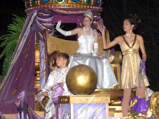 The Queen's Parade rolls through Lafayette Monday night.By