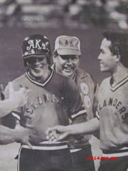 Eddie Aguon is greeted by his Atkins Kroll Islanders teammates after hitting a home run in this file photo dated April 8, 1982.