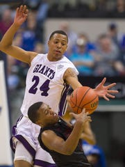Ben Davis High School sophomore Jalen Windham (24) goes after the loose ball with Fort Wayne North Side High School junior Alijah Long (11) during the first half of the IHSAA 2017 Class 4A State Championship Game at Banker's Life Fieldhouse in Indianapolis, Saturday, March 25, 2017.