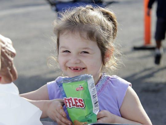 Allison Nevarez, 3, smiles for a photo while her mother