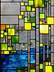 Stained glass by Josephine Gieger, part of the 10th