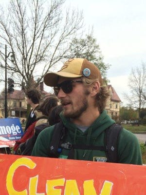 Andrew Harvey, a senior at the University of Vermont, joined a march to Burlington City Hall to register to vote.