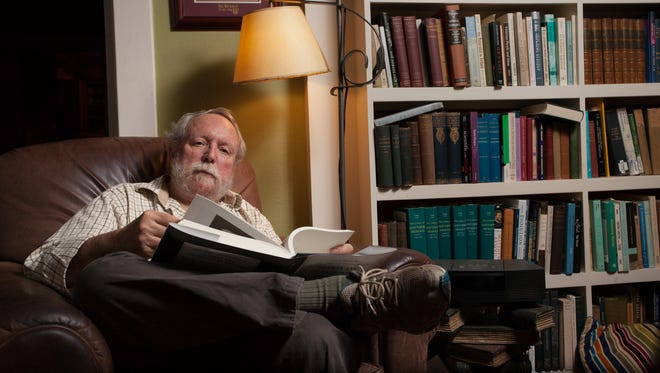 Professor Michael Ruse poses for a portrait in his home on Tuesday, June 3, 2014 in Tallahassee, Fla.