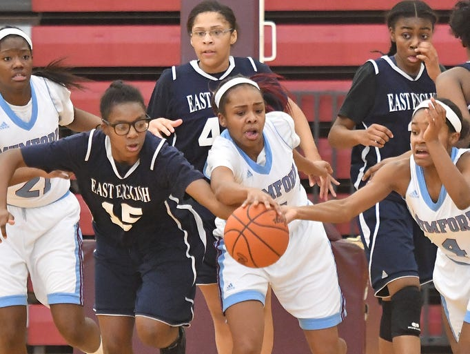 East English's C'erra MaHolmes, left, fights for a