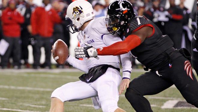 UC linebacker Jeff Luc sacks East Carolina University quarterback Shane Carden on Nov. 13.