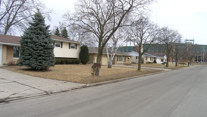 The Green Bay Packers purchased 1070 Blue Ridge Drive, the middle house in the photo, in February. They already owned the property on each side of the house.