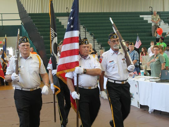 From left: Paul Clenny, Albert Cox and Jerry Phillips of the American Legion Post 243 Scotts Hill present the colors at the Welcome Home Veterans event Saturday at Jackson State Community College.