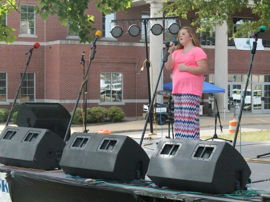 Henderson seventh-grader Sydney Thompson performs a song Friday at the annual Chester County BBQ Festival.