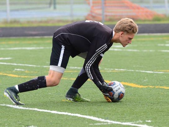 Marysville High School senior Brett Robinson grabs